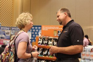 Merrick talks to customer at convention